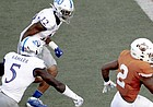 Texas running back Roschon Johnson (2) scores a touchdown against Kansas during an NCAA college football game Saturday, Oct. 19, 2019, in Austin, Texas. (Nick Wagner/Austin American-Statesman via AP)