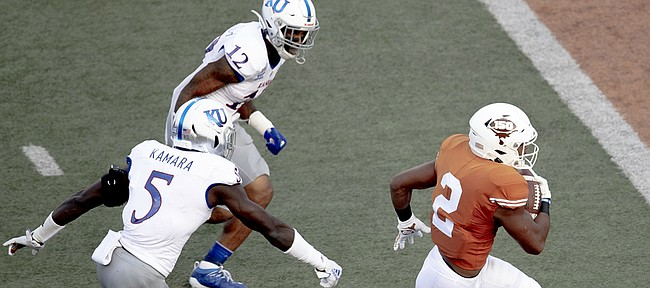 Texas running back Roschon Johnson (2) scores a touchdown against Kansas during an NCAA college football game Saturday, Oct. 19, 2019, in Austin, Texas. (Nick Wagner/Austin American-Statesman via AP)
