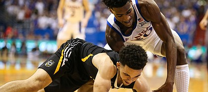 Kansas guard Ochai Agbaji (30) tangles with Fort Hays State guard Aaron Nicholson (1) for a ball in the corner during the first half, Thursday, Oct. 24, 2019 at Allen Fieldhouse.