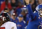 Kansas quarterback Carter Stanley (9) passes during during the Kansas-Texas Tech game Saturday at Memorial Stadium.
