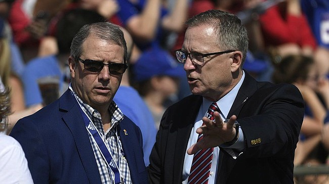 Kansas chancellor Doug Girod and Athletics Director Jeff Long talk before the game Saturday afternoon at David Booth Kansas Memorial Stadium on Aug. 31, 2019.