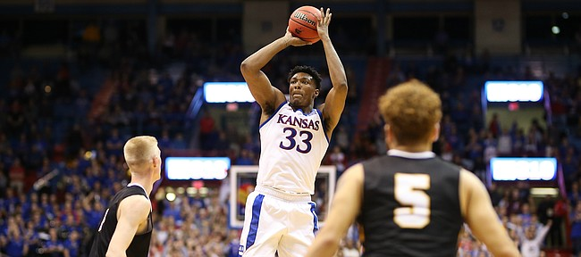 Kansas forward David McCormack (33) pulls up for a shot against Fort Hays State forward Bjarni Jonsson (4) during the second half, Thursday, Oct. 24, 2019 at Allen Fieldhouse.