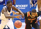 Kansas guard Marcus Garrett (0) steals the ball from Pittsburg State guard Jah-Kobe Womack (3) during the first half, Thursday, Oct. 31, 2019 at Allen Fieldhouse.