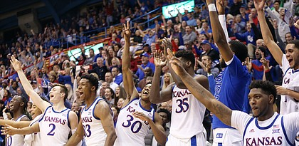 The Kansas bench celebrates a 3-point basket by freshman guard Michael Jankovich to reach 100 points in a 102-42 win against Pittsburg State Thursday at Allen Fieldhouse.