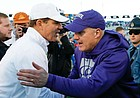 Kansas head coach Les Miles congratulates Kansas State head coach Chris Klieman following the Wildcats' 38-10 win over the Jayhawks on Saturday, Nov. 2, 2019 at Memorial Stadium.