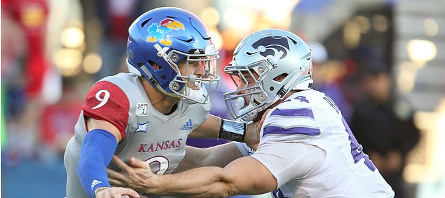 Kansas quarterback Carter Stanley (9) is sacked by Kansas State defensive end Kyle Ball (44) during the fourth quarter on Saturday, Nov. 2, 2019 at Memorial Stadium.