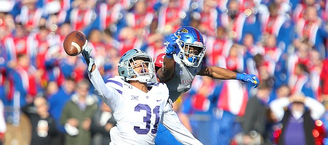 Kansas State defensive back Jahron McPherson (31) disrupts a pass to Kansas wide receiver Stephon Robinson Jr. (5) during the second quarter on Saturday, Nov. 2, 2019 at Memorial Stadium.