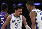 Duke guard Tre Jones (3) and guard Cassius Stanley (2) react after a basket during the second half of the team's NCAA college basketball game against Kansas on Tuesday, Nov. 5, 2019, in New York. (AP Photo/Adam Hunger)
