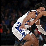 Kansas guard Devon Dotson (1) drives to the basket past Duke guard Tre Jones during the first half of an NCAA college basketball game Tuesday, Nov. 5, 2019, in New York. (AP Photo/Adam Hunger)