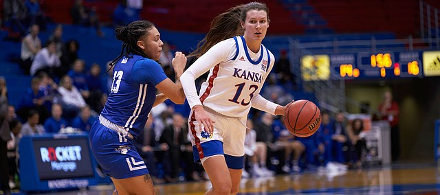 KU freshman guard Holly Kersgieter (13) looks to make a play past Indiana State Leandra Echi (13). KU defeated Indiana State 84-72 on Thursday, Nov. 7.