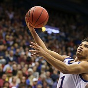 Kansas guard Devon Dotson (1) floats in for a bucket against UNC-Greensboro guard Malik Massey (2) during the second half, Friday, Nov. 8, 2019 at Allen Fieldhouse.