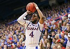 Kansas guard Isaiah Moss (4) squares himself up for a a three during the second half, Friday, Nov. 8, 2019 at Allen Fieldhouse.