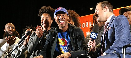 New Kansas basketball commitment Bryce Thompson flashes a smile after revealing his college choice during a ceremony at Booker T. Washington High in Tulsa, Okla., on Tuesday, Nov. 12, 2019.