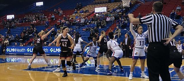 Senior guard Niccolly Ramalho and Kansas women's basketball defends an inbound pass. KU defeated Omaha 63-48 on Wednesday, Nov. 13.