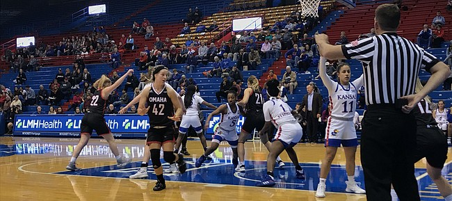 Senior guard Niccolly Ramalho and Kansas women's basketball defends an inbound pass. KU defeated Omaha 63-48 on Wednesday, Nov. 13, 2019.