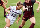 KU's Katie McClure (12) races for possession as Loyola's Madison Laudeman (19) plays defense during the team's 6-0 win over Loyola Chicago Sunday afternoon at Rock Chalk Park on Aug. 25, 2019.