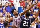Kansas center Udoka Azubuike (35) stuffs a shot by Monmouth forward Nikkei Rutty (21) during the first half on Friday, Nov. 15, 2019 at Allen Fieldhouse.