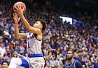 Kansas guard Devon Dotson (1) gets in for a layup during the first half on Friday, Nov. 15, 2019 at Allen Fieldhouse.
