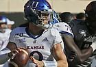 Kansas quarterback Carter Stanley (9) passes in the first half of an NCAA college football game against Oklahoma State in Stillwater, Okla., Saturday, Nov. 16, 2019. (AP Photo/Sue Ogrocki)