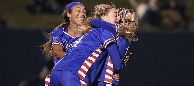 Kailey Lane (center), Sam Barnett (left), and Katie McClure (right) celebrate a goal by Lane against Iowa Saturday night at Rock Chalk Park on Nov. 16, 2019.