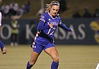 Katie McClure dribbles the ball against Iowa in the NCAA Tournament Saturday night at Rock Chalk Park on Nov. 16, 2019.