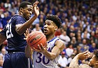 Kansas guard Ochai Agbaji (30) is fouled on the shot as he gets between Monmouth forward Nikkei Rutty (21) and Monmouth guard Deion Hammond (3) during the first half on Friday, Nov. 15, 2019 at Allen Fieldhouse.
