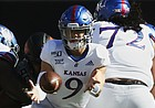 Kansas quarterback Carter Stanley (9) pitches the ball in the first half of an NCAA college football game against Oklahoma State in Stillwater, Okla., Saturday, Nov. 16, 2019. (AP Photo/Sue Ogrocki)