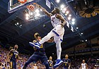 Kansas center Udoka Azubuike (35) powers in a dunk against East Tennessee State center Lucas N'Guessan (25) during the second half on Tuesday, Nov. 19, 2019 at Allen Fieldhouse.