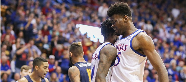 Kansas center Udoka Azubuike (35) bumps chests with Kansas guard Marcus Garrett (0) after Garrett finished a bucket with a foul during the first half on Tuesday, Nov. 19, 2019 at Allen Fieldhouse.