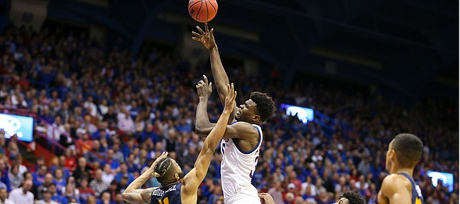 Kansas center Udoka Azubuike (35) turns for a shot over East Tennessee State forward Jeromy Rodriguez (11) during the first half on Tuesday, Nov. 19, 2019 at Allen Fieldhouse.