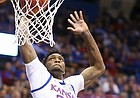 Kansas forward Silvio De Sousa (22) throws down a lob jam before East Tennessee State forward Vonnie Patterson (23) during the first half on Tuesday, Nov. 19, 2019 at Allen Fieldhouse.