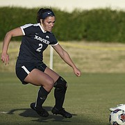 Kansas senior Katie McClure controls the ball in the open field during the Jayhawks' 3-0 victory over Xavier on Friday, Nov. 22, 2019 in Columbia, S.C. McClure scored all three KU goals.