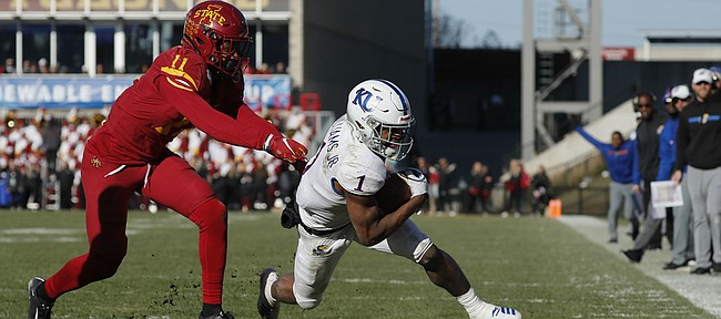Iowa State defensive back Lawrence White, left, chases down Kansas running back Pooka Williams, right, during the second half of an NCAA college football game, Saturday, Nov. 23, 2019, in Ames, Iowa. Iowa State won 41-31. (AP Photo/Matthew Putney)