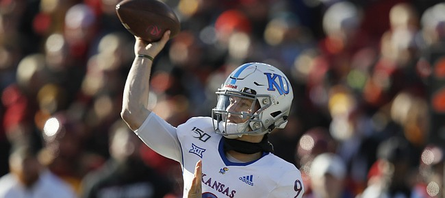 Kansas quarterback Carter Stanley passes the ball during the second half of an NCAA college football game against Iowa State, Saturday, Nov. 23, 2019, in Ames, Iowa. Iowa State won 41-31. (AP Photo/Matthew Putney)