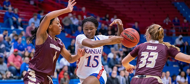 KU freshman guard Zakiyah Franklin (15) tries to drive dribble pass Texas State Avionne Alexander (1) and Bailey Holly (33). KU defeated Texas State 68-48 on Sunday, Nov. 24.
