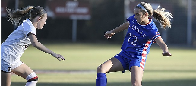 Kansas senior Katie McClure makes a move on a defender against South Carolina Sunday afternoon at Stone Stadium on Nov. 24, 2019.
