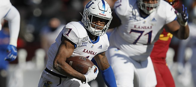 Kansas running back Pooka Williams runs the ball against Iowa State during the first half of an NCAA college football game, Saturday, Nov. 23, 2019, in Ames, Iowa. (AP Photo/Matthew Putney)