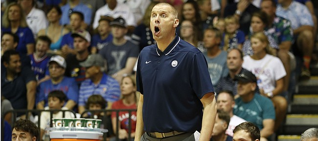 BYU head coach Mark Pope reacts to play as his team takes on Kansas during the first half of an NCAA college basketball game Tuesday, Nov. 26, 2019, in Lahaina, Hawaii. (AP Photo/Marco Garcia)