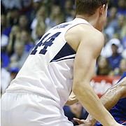 Kansas guard Devon Dotson (1) tries to get around BYU guard Connor Harding (44) during the first half of an NCAA college basketball game Tuesday, Nov. 26, 2019, in Lahaina, Hawaii. (AP Photo/Marco Garcia)