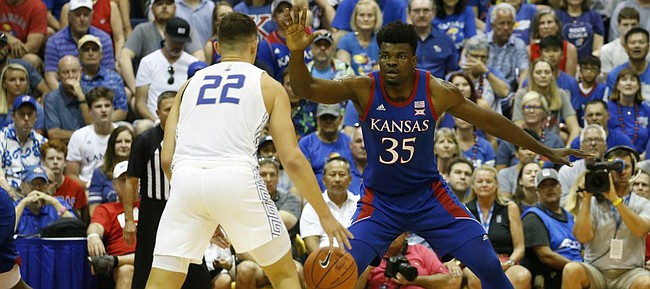 Kansas center Udoka Azubuike (35) guards Chaminade guard Kevin Kremer (22) during an NCAA college basketball game against Chaminade Monday, Nov. 25, 2019, in Lahaina, Hawaii. (AP Photo/Marco Garcia)