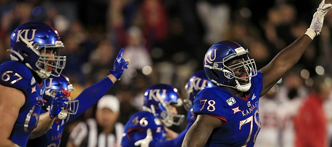 Kansas offensive lineman Hakeem Adeniji (78) celebrates a game-winning field goal at the end of an NCAA college football game against Texas Tech in Lawrence, Kan., Saturday, Oct. 26, 2019. Kansas defeated Texas Tech 37-34. (AP Photo/Orlin Wagner)
