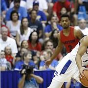 Kansas guard Devon Dotson (1) collides Dayton guard Dwayne Cohill during the first half of an NCAA college basketball game Wednesday, Nov. 27, 2019, in Lahaina, Hawaii. (AP Photo/Marco Garcia)
