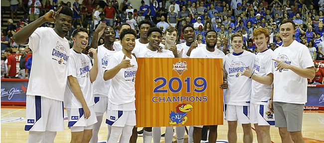 Kansas stands center court after defeating Dayton in 90-84 in overtime in an NCAA college basketball game Wednesday, Nov. 27, 2019, in Lahaina, Hawaii. (AP Photo/Marco Garcia)