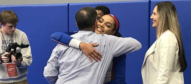 Kansas senior middle blocker Zoe Hill hugs head coach Ray Bechard on KU volleyball's senior night. KU defeated Iowa State 3-2 (25-14, 25-23, 25-22, 26-24, 15-12) on Wednesday, Nov. 27.