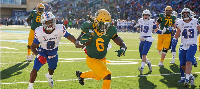 Baylor Bears running back JaMycal Hasty (6) gets into the end zone for a touchdown past Kansas cornerback Kyle Mayberry (8) during the first quarter on Saturday, Nov. 30, 2019 at Memorial Stadium.