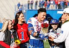 Kansas safety Bryce Torneden (1) receives a commemorative football from Kansas head coach Les Miles during the senior recognition ceremony on Saturday, Nov. 30, 2019 at Memorial Stadium.