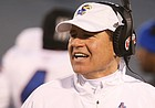 Kansas head coach Les Miles gets the attention of an official as he disputes a call during the third quarter on Saturday, Nov. 30, 2019 at Memorial Stadium.