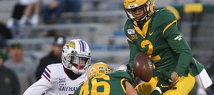 Baylor Bears linebacker Blake Lynch (2) picks off a pass intended for Kansas wide receiver Andrew Parchment (4) during the third quarter on Saturday, Nov. 30, 2019 at Memorial Stadium.