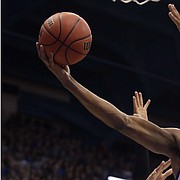 Kansas' Ochai Agbaji (30) gets past Colorado's D'Shawn Schwartz (5) to put up a shot during the first half of an NCAA college basketball game Saturday, Dec. 7, 2019, in Lawrence, Kan. (AP Photo/Charlie Riedel)
