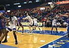 Kansas defends an in-bounds play from Florida. KU defeated Florida 76-66 in the Big 12/SEC Challenge on Sunday, Dec. 8.